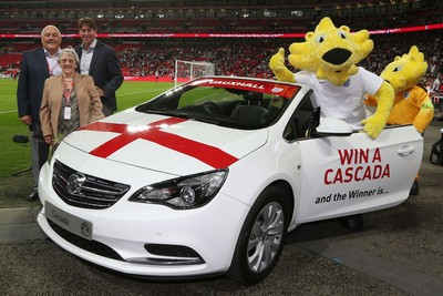 England legend presents lucky Three Lions fan with Vauxhall Cascada